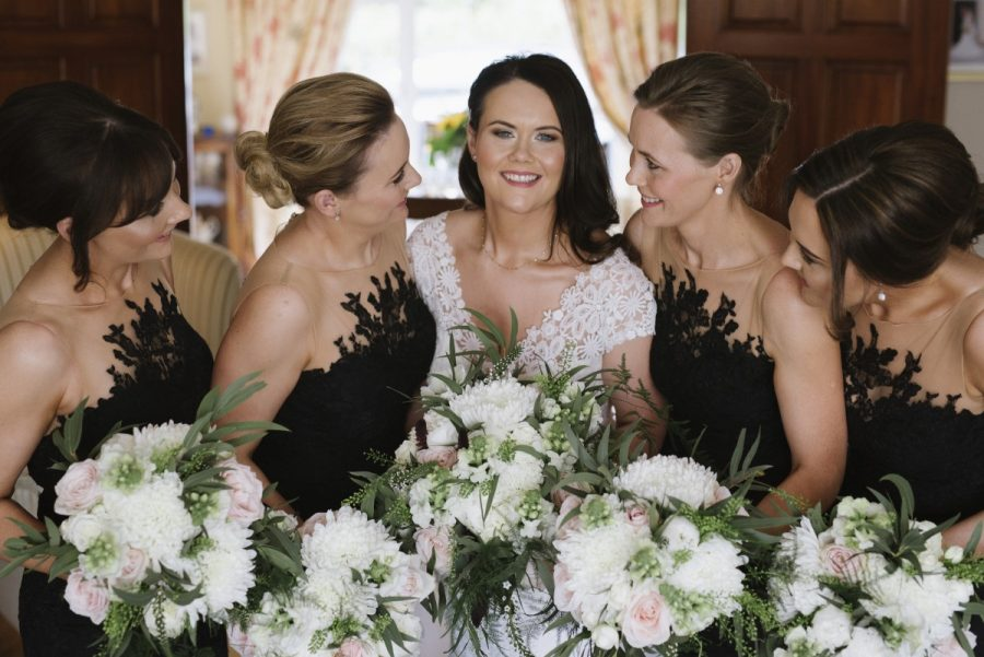bride bridesmaids flower bouquets white greenery