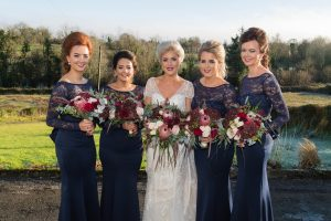 claire and her bridesmaids fermanagh wedding navy dresses bouquets wild green pale pink burgandy flowers chrisrtmas wedding