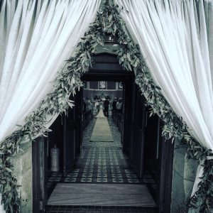entrance to kinawley wedding with drapes and foilage ideas christmas
