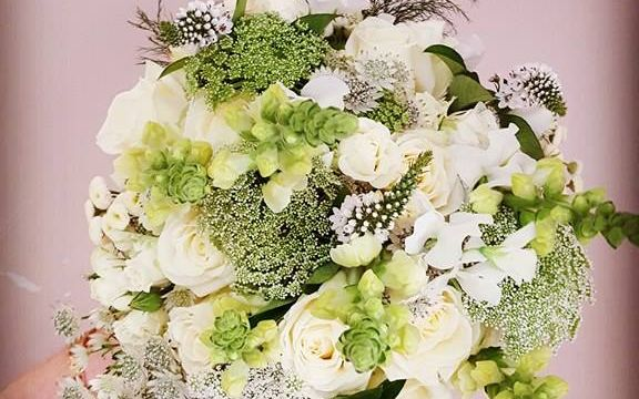 WILD HANTIE WEDDING BOUQUET WITH SOME GREENERY AND WHITE FLOWERS
