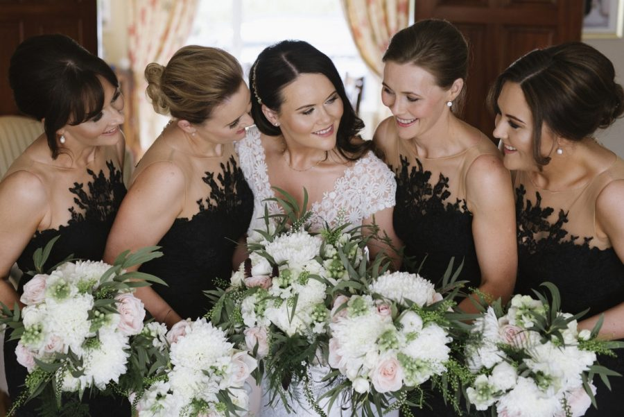 black bridesmaids dresses bouquets white greenery