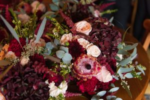burgandy hydrangea bridesmaids bouquets christmas wedding peach roses